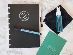 uitwisbaar notitieboek met spray en doek
